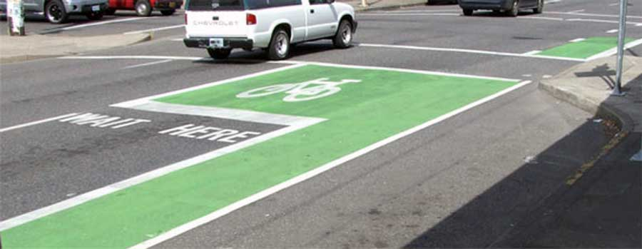 Portland green bike box - bike lane indicates a trouble spot for drivers to pay more attention and look for cyclists and pedestrians